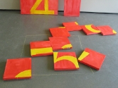 9 PIECES OF 5. 2007. 45cm square canvases on wheels.